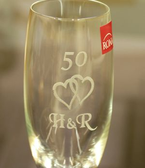 Champagne flute with text and heart motif