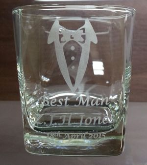 Whisky glass with bow tie engraving