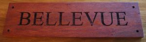 Red gum sign engraved with 4 mounting holes