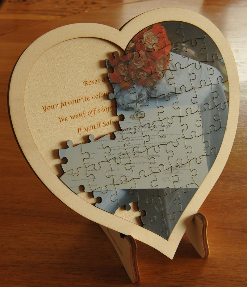 Thumb_Heart jigsaw on timber frame and stand ( pieces removed to show text on stand )