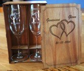 Engraved champagne glass set in blackwood box