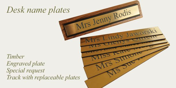 Desk sign timber with track for replaceable plates