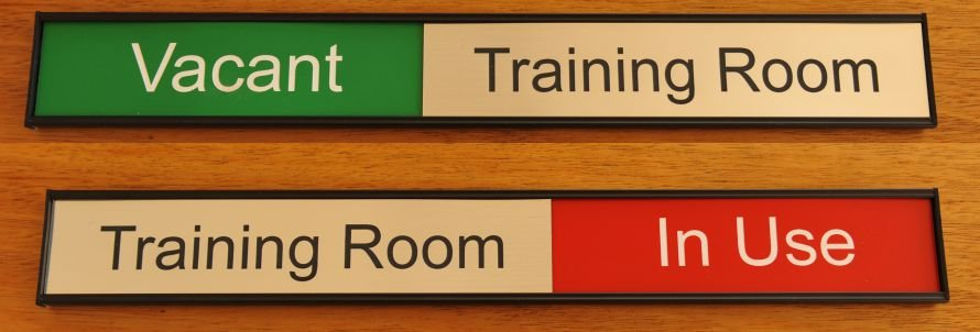Training room sign with red and green highlight