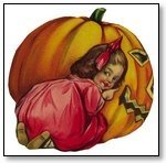 Halloween girl with red bow kneeling next to punmkin 187